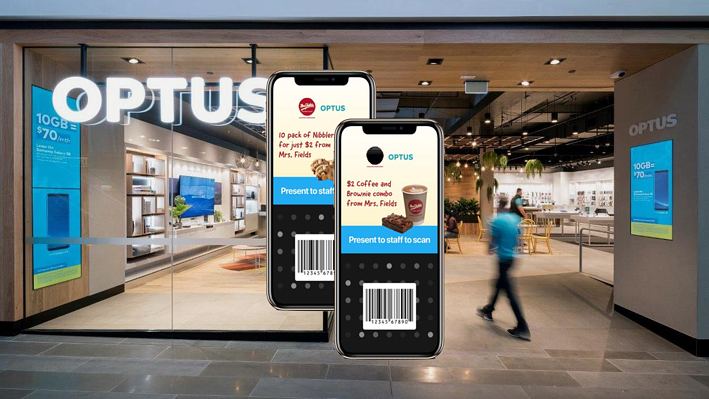 2 iphones displaying Optus Perks' digital coupons against a background of an Optus store